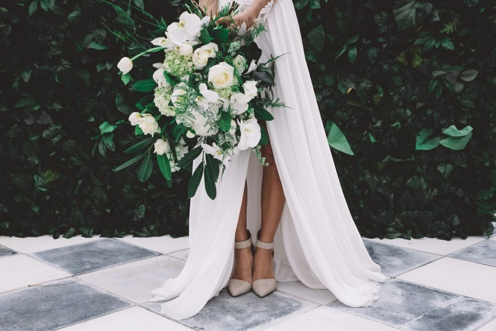 Photoshoot at Campbell Point house featuring Berta Bridal, large green and ivory floral bouquet