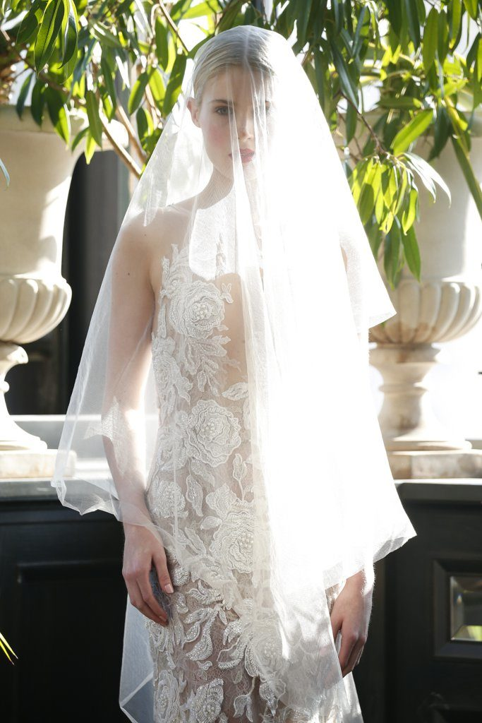 Bright lips and blush stand out under a veil in the most gorgeous way.