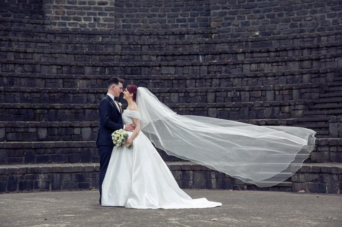 Melbourne bride carly married in a raffaele ciuca silk wedding dress