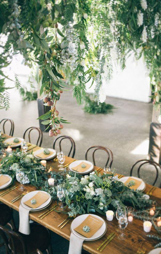 wedding styling timber tables with greenery
