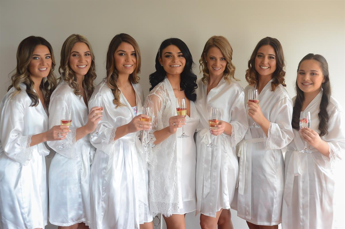 Bridesmaid photo in robes of real bride michelle wearing Beca by Pronovias wedding dress