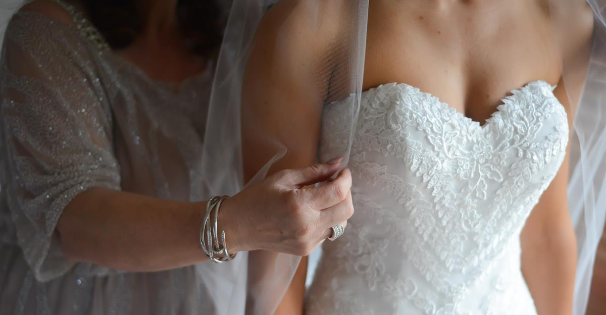 Close up wedding photo of real bride michelle wearing Beca by Pronovias wedding dress