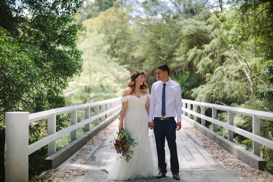 Real Bride Sam wore a stunning bohemian wedding dress from Raffaele Ciuca with a bright floral flower crown for her forest wedding.