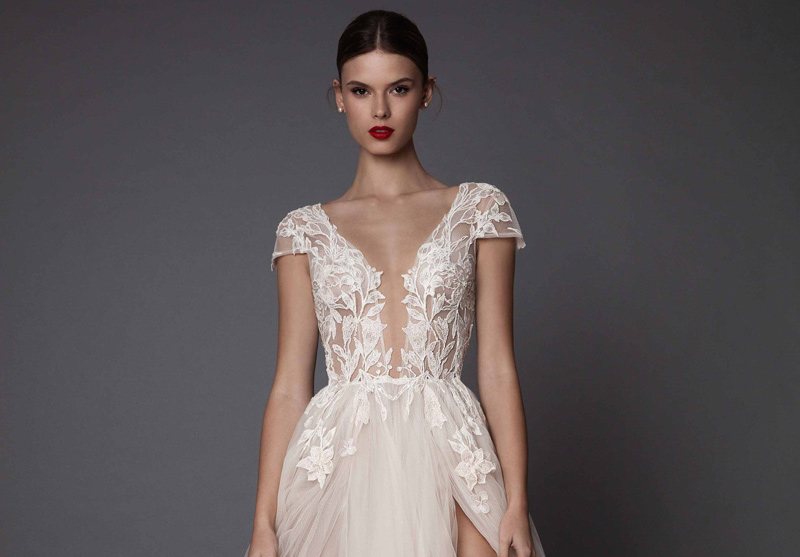 Lace wedding dress with plunging neckline, tulle skirt and front leg split