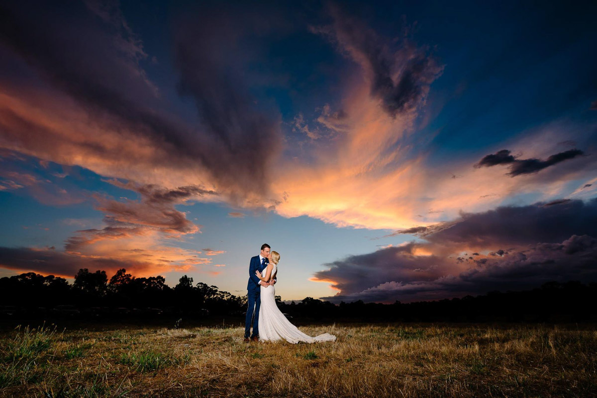 Raffaele Ciuca real bride wearing Ornani wedding dress by Pronovias, sunset photo