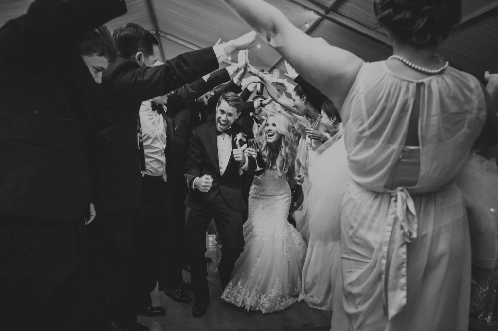 bride and groom tunnel reception