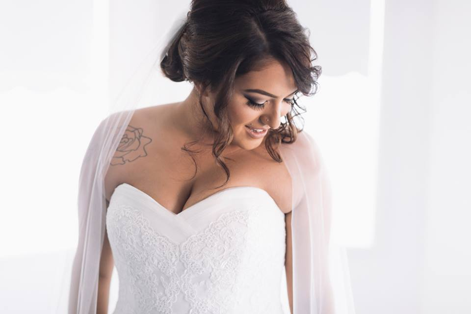 real bride wears mullet wedding dress by la sposa
