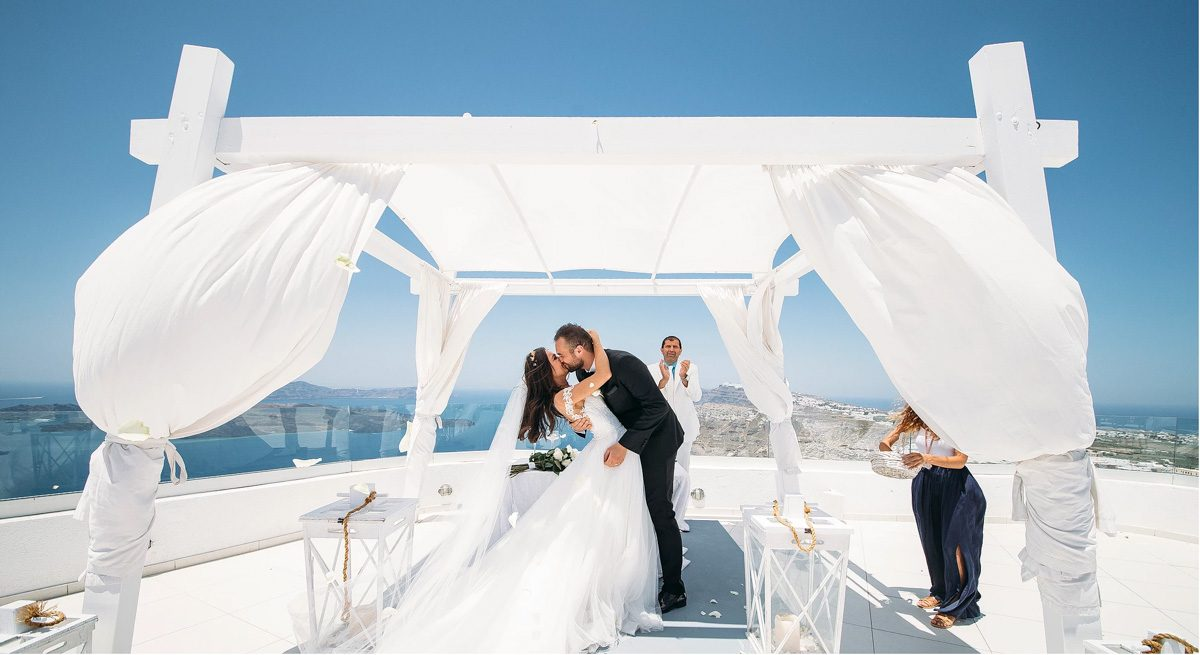 real bride wears Pronovias wedding dress for destination wedding in Santorini Greece