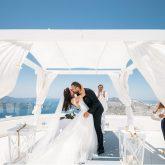 real bride wears Pronovias wedding dress for destination wedding in Santorini Greece