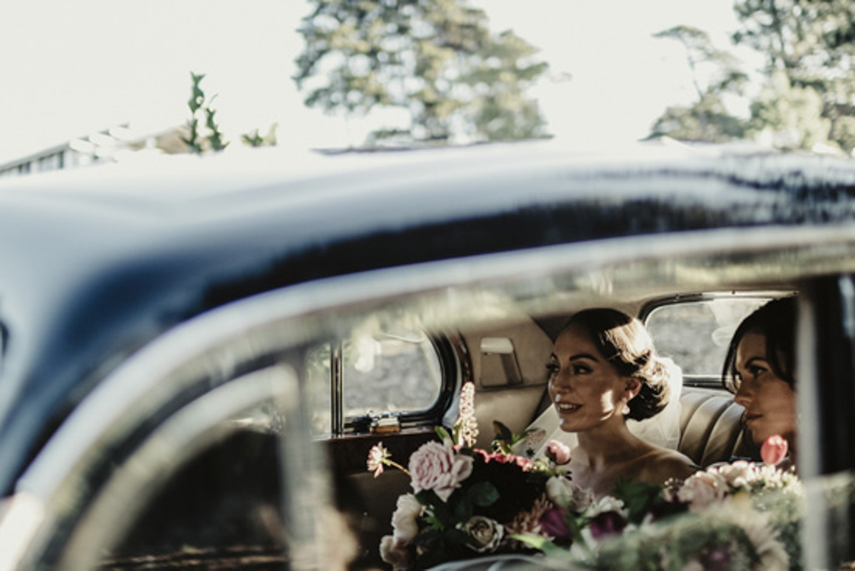 bride in the car photo native bouquet