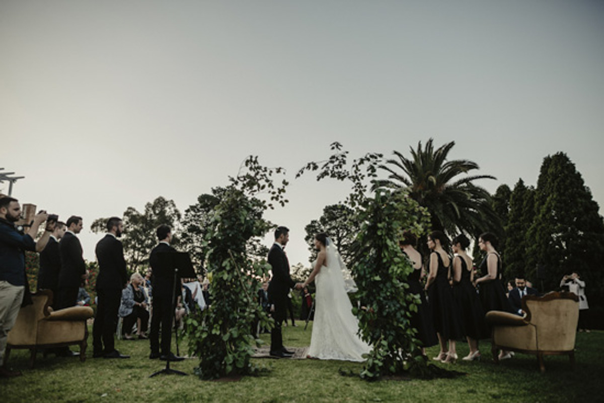 leafy wedding arbour bride and groom ceremony