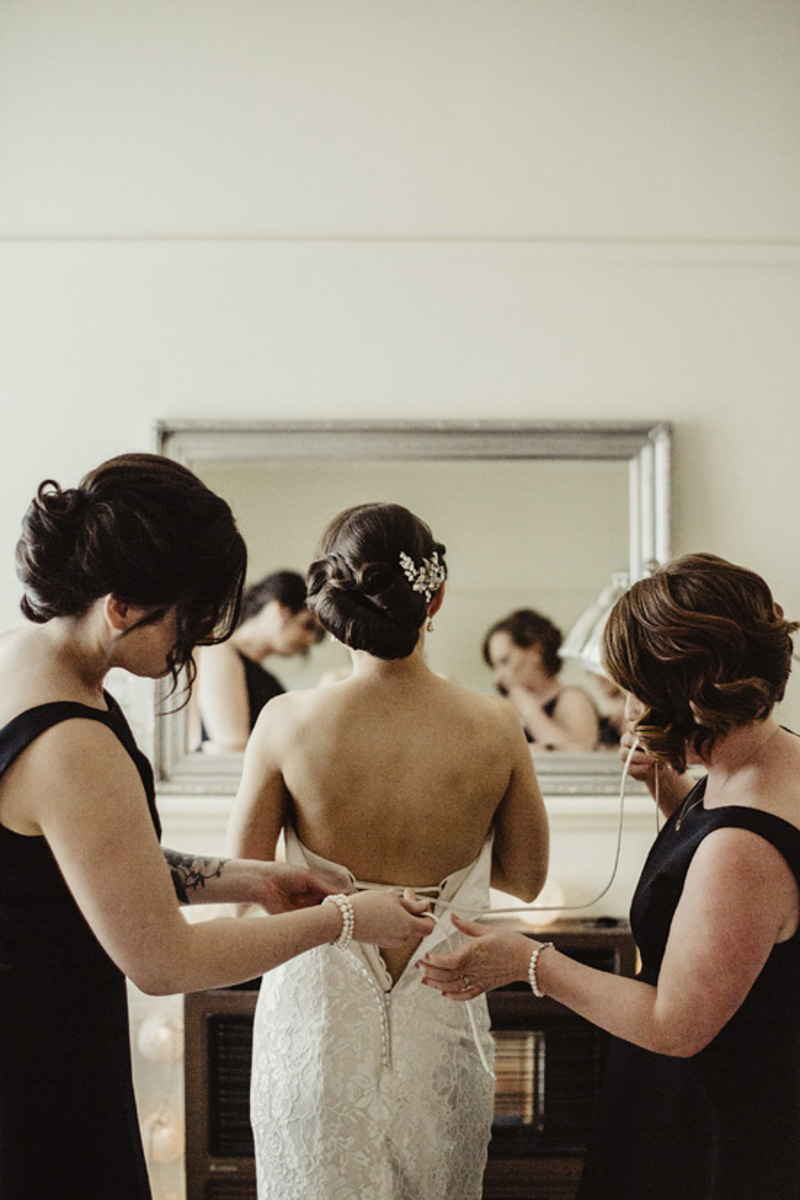 bride getting ready photo with bridesmaids