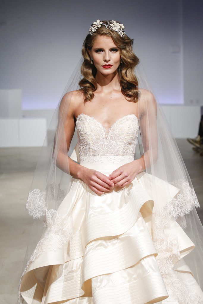 Old Hollywood waves and a classic red lip is a timeless combination. Adding a chic floral hairpiece makes it more bridal and less red carpet.