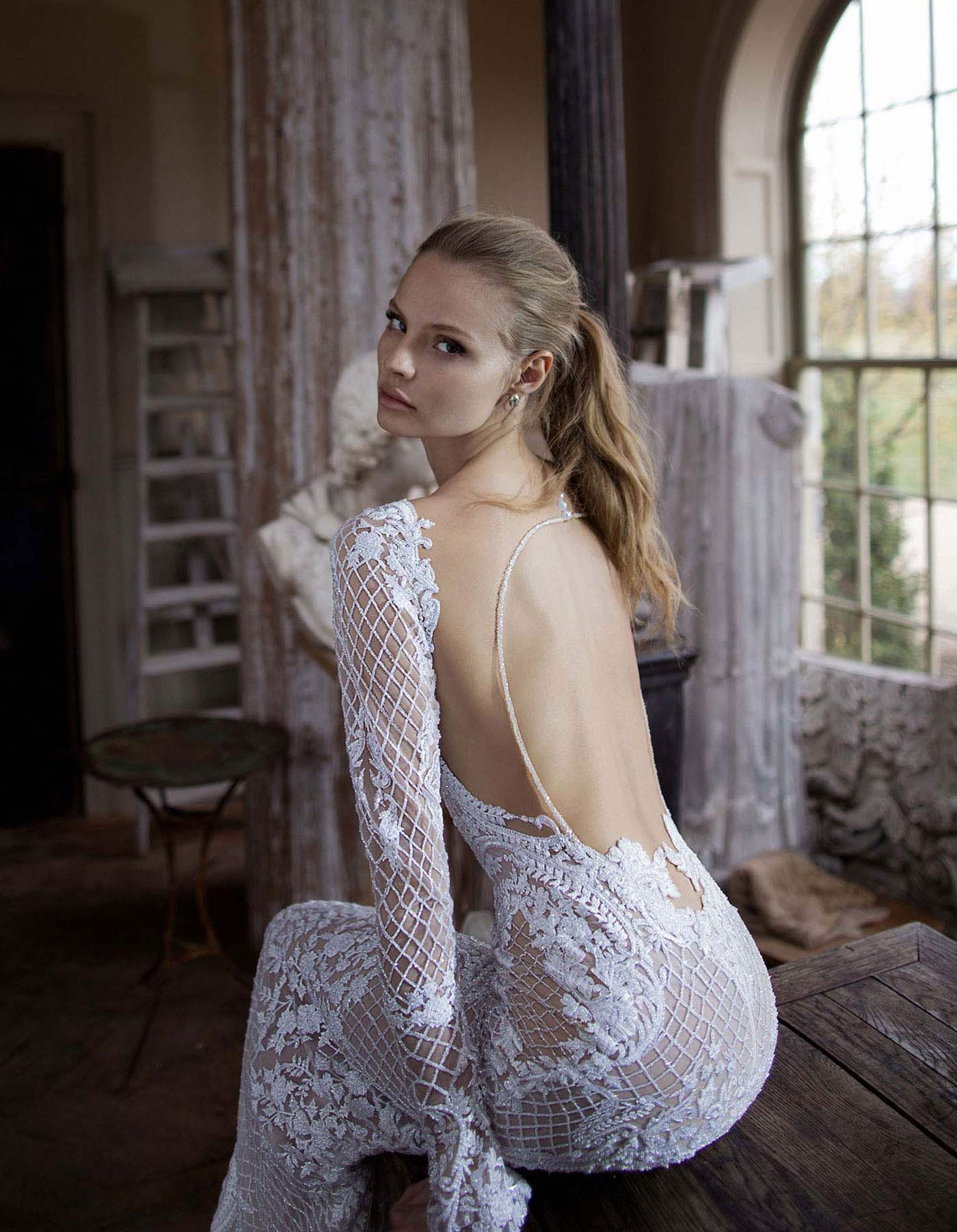 Berta Bridal 16-123 a backless lace wedding dress with long sleeves