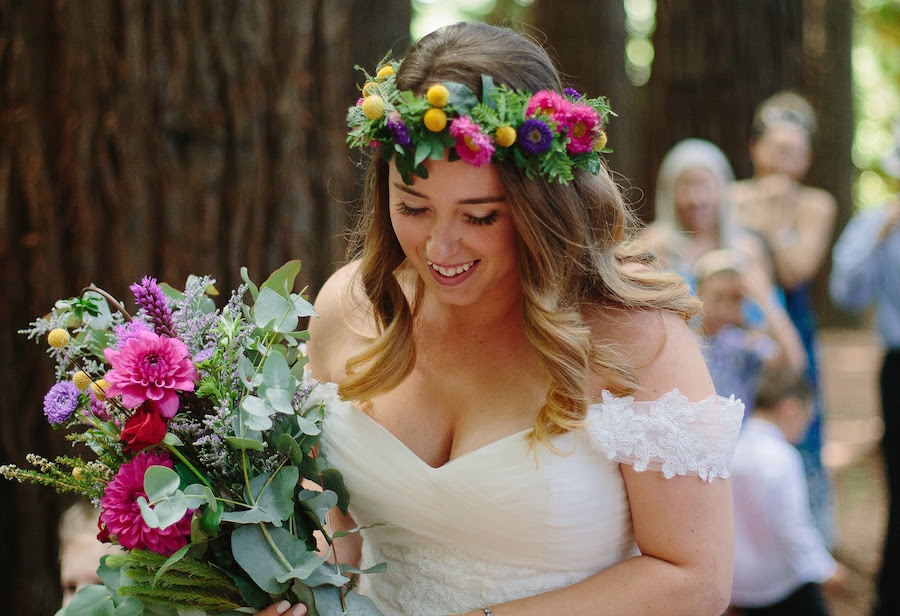 Real Bride Sam wore a wedding dress with off the shoulder sleeves and a colourful flower crown for woodland wedding