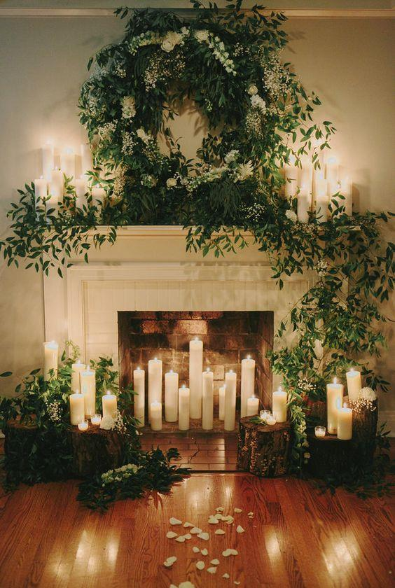 candles and greenery decorated fireplace