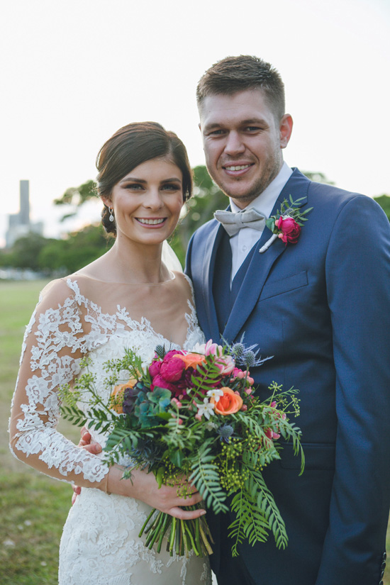 bride and groom photo colourful flower bouquet off the shoulder lace wedding dress