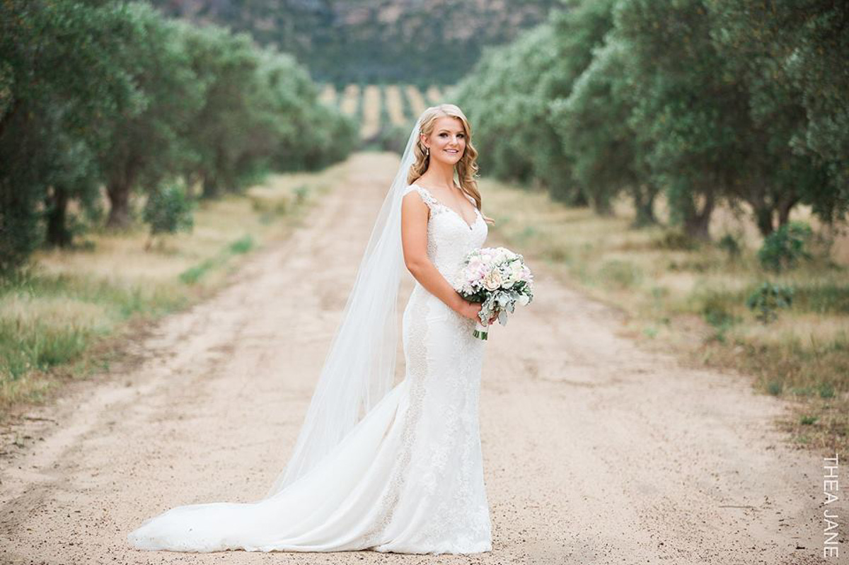 real bride wears tamar wedding dress by pronovias