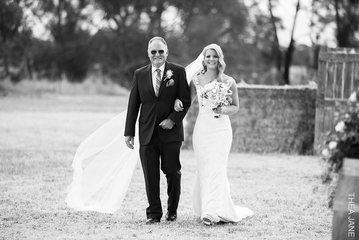 real bride walking with father wearing  tamar wedding dress by pronovias