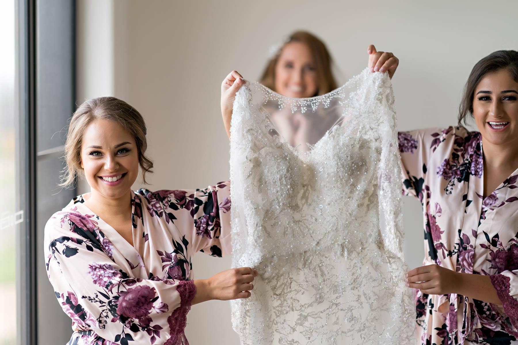 Melina + Vuong RC Real Bride Wearing Demetrios Platinum Wedding dress in 'Analisa'